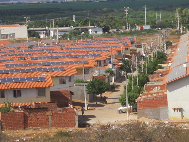 This housing complex for a thousand poor families in Juazeiro, in the Northeastern Brazilian state of Bahia, was built at the beginning of the last decade with 9,144 solar panels to generate electricity for self-consumption and sell the surplus. In 2016, the monthly payment of about 18 dollars to each resident was suspended because the project did not meet all the requirements for distributed generation. CREDIT: Mario Osava/IPS
