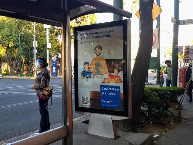 An ad for household gas at a bus stop in Mexico City. The Mexican government promotes the exploitation, distribution and consumption of natural gas, despite the social conflicts and environmental impacts that the industry causes. CREDIT: Emilio Godoy/IPS