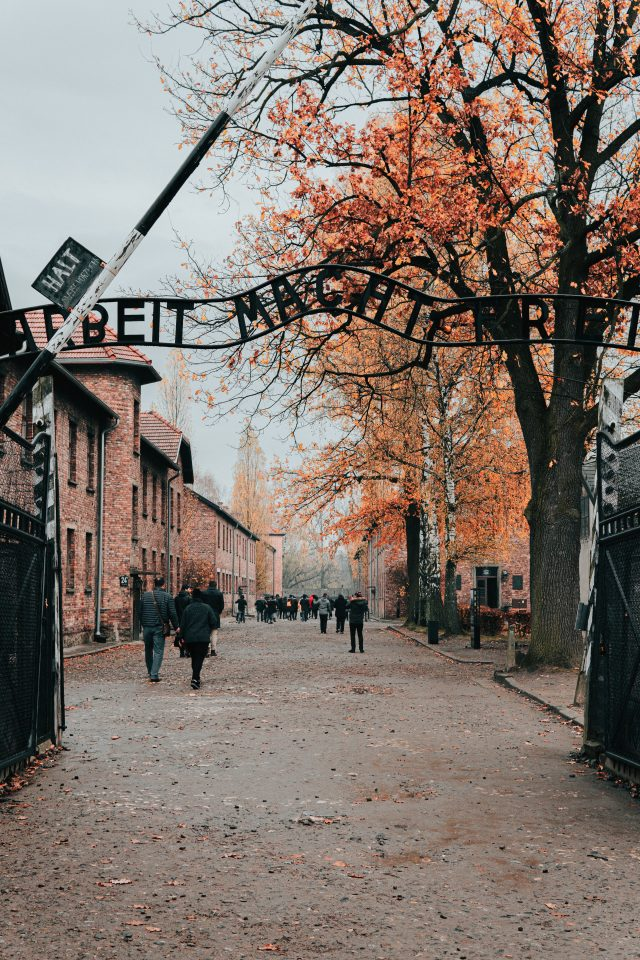 The gates of World War II concentration camp, Auschwitz. Approximately 1.1 million people — including 900,000 Jews — were killed in the biggest extermination camp from World War II. Photo by Jean Carlo Emer on Unsplash
