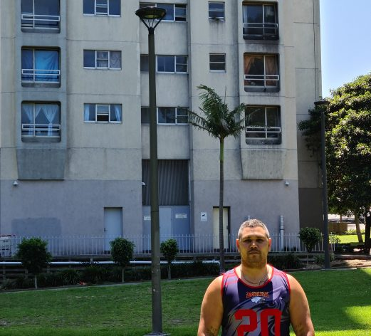 Keenan Mundine outside The Block, an Aboriginal community social housing area where he grew up. Today, he is using his own lived experience of navigating the criminal justice system that helped change the trajectory of his life to devise creative and innovative solutions for Aboriginal and Torres StraitIslander (ATSI) people so they can break free from the cycle of violence, police and prisons. Credit: Neena Bhandari /IPS