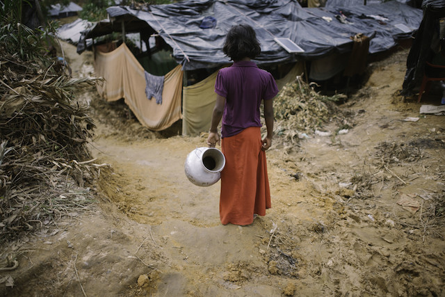 A Rohingya girl goes to fetch water in Cox's Bazar, Bangladesh. A Mar. 22 fire spread through the camp, damaging important infrastructure including hospitals, learning centres, aid distribution points and a registration centre. While a few learning centres were burnt down, a number of them were not affected by the fire. (file photo)Credit: Umer Aiman Khan/IPS