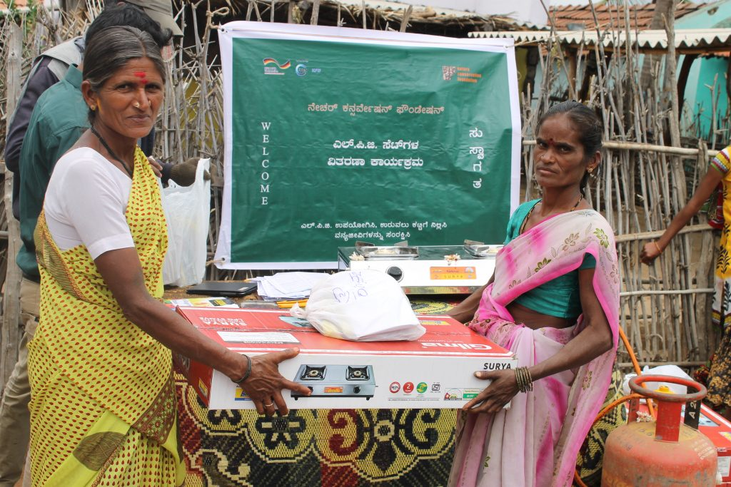 Forest women receive LPG stove and cylinder in the Malai Mahadeshwara Hills Wildlife Sanctuary. In a dramatic shift towards sustainability, thousands of forest dwellers have moved to a forest-friendly fuel to save the habitat of the sanctuary's wild animals thanks to a project spearheaded by Nature Conservation Foundation (NCF) and IUCN. Courtesy: Sanjay Gubbi/NCF
