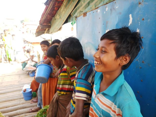 Education Cannot Wait (ECW)  was among the very first responders to the Rohingya refugee influx in 2017 and able to quickly provide them with educational services and psycho-social support. Pictured here is Mohammad Rafique, along with other refugee children, gathered at the Rohingya market of Kutupalong camp. The photo was taken last March just two weeks before Bangladesh went into a nationwide lockdown in an attempt to contain the spread of the coronavirus. Credit: Rafiqul Islam/IPS
