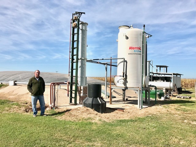 José Luis Barrinat, manager of the Monje Agricultural and Livestock Cooperative, stands by the biodigester, next to the gas filter and the facilities where the gas is cooled before being sent to the electricity generator. The biodigester works with effluent from the pig farm and other organic waste. CREDIT: Courtesy of CopMonje