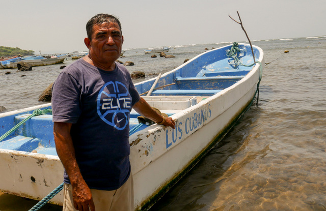 Fisherman Luis Morán, a resident of Punta Remedios beach in the hamlet of Los Cóbanos in western El Salvador, says human activities such as overfishing and unsustainable tourism are damaging the health of the coral reef located in that area of the Pacific coast, the only one of its kind in the country. CREDIT: Edgardo Ayala/IPS