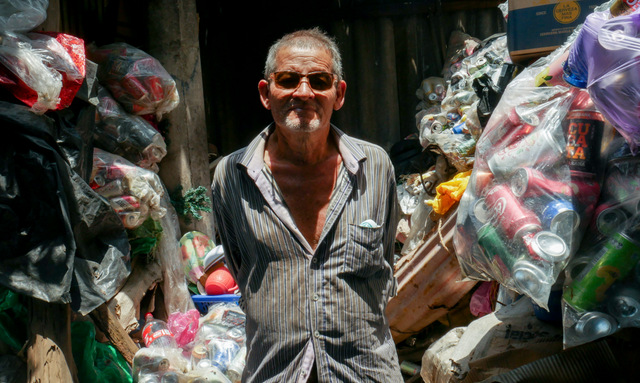José Cruz Miranda, a resident of Los Cóbanos, a village on the Salvadoran coast, was a fisherman for more than 30 years, but had to stop due to health problems. Now he gathers empty cans, which he sells to a recycling company - environmental work that helps reduce pollution in an area with rich coral communities. CREDIT: Edgardo Ayala/IPS
