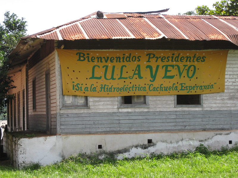 Hydroelectricity is no longer the overwhelmingly predominant source of energy in Brazil, as sources such as wind and solar gain ground. All that remains of some mega-projects are old signs, like this one in Cachuela Esperanza, a Bolivian town where former presidents Evo Morales of Bolivia and Luiz Inácio Lula da Silva of Brazil announced the construction of a large binational hydroelectric plant on the Beni River, which never materialised. CREDIT: Mario Osava/IPS