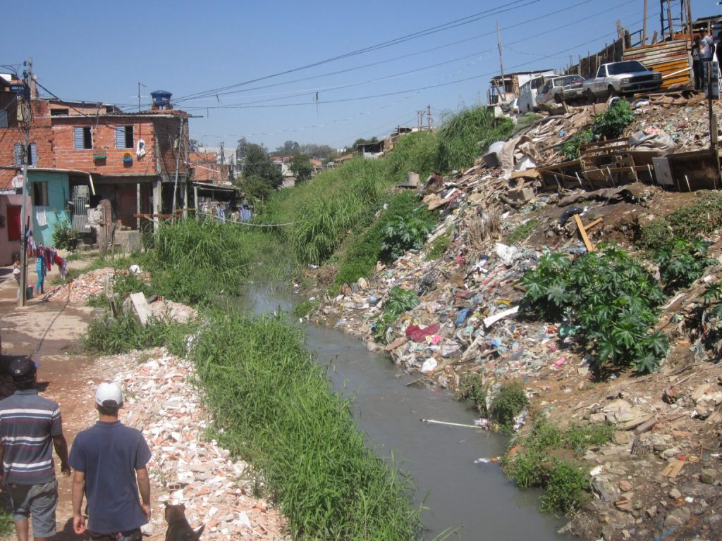 One of the favelas or shantytowns of São Paulo, Brazil's largest city, where local residents have turned a stream into an open-air garbage dump and a source of frequent flooding due to lack of sewage and garbage collection. Nor do favelas in Brazil's cities have piped water. CREDIT: Mario Osava/IPS